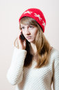 Beautiful young woman chatting mobile cell phone talking on in knitwear Royalty Free Stock Images