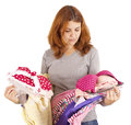 Beautiful young woman choosing clothes. Royalty Free Stock Images