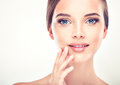 Beautiful young woman with clean fresh skin close up Stock Image