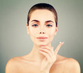 Beautiful Young Woman with Clean Fresh Skin holding Cream Drop Royalty Free Stock Photo