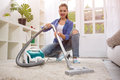 Beautiful young woman cleaning with vacuum cleaner Royalty Free Stock Photo