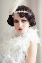 Beautiful young woman close up portrait in retro flapper style vogue style vintage Royalty Free Stock Photo