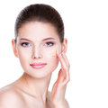 Beautiful young woman with cosmetic foundation on a skin beauty treatment concept Royalty Free Stock Photos