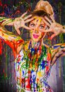 Beautiful young woman covered with paints multicolored Royalty Free Stock Image