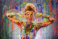 Beautiful young woman covered with paints multicolored Stock Images