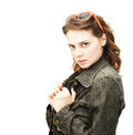 Beautiful young woman in a denim jacket with sun glasses isolated on white background Royalty Free Stock Photo