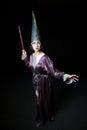 Beautiful young woman doing magic Royalty Free Stock Photo