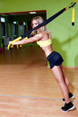 Beautiful young woman doing TRX exercises Royalty Free Stock Photo