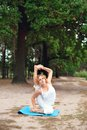 Beautiful young woman doing yoga exercise outdoors Royalty Free Stock Photography