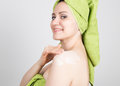 Beautiful Young woman dressed in a bath towel makes cosmetic mask on the face. beauty industry and home skin care Royalty Free Stock Photo