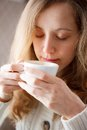 Beautiful young woman drinking coffee cup hot beverage coffee break Royalty Free Stock Photos