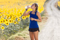 Beautiful young woman drinking water after running in countrysid Royalty Free Stock Photo