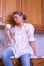 Beautiful young woman drinks coffee Stock Photos