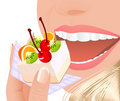 Beautiful young woman eating fruit cake Stock Images