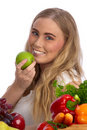 Beautiful young woman eating green apple Royalty Free Stock Photos