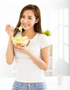 Beautiful young woman eating healthy food Royalty Free Stock Photo