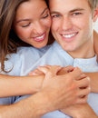 Beautiful young woman embracing man from the back Stock Photo