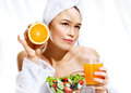 Beautiful young woman of the european appearance after taking a shower enjoying a healthy food.