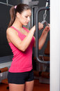 Beautiful young woman exercising arm muscles Royalty Free Stock Photo