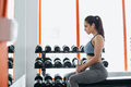 Beautiful young woman exercising with dumbbell in the gym. Royalty Free Stock Photo