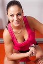 Beautiful young woman exercising with dumbbell Royalty Free Stock Photo