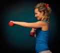 Beautiful young woman exercising in the gym Royalty Free Stock Images