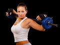 Beautiful young woman exercising with weights Royalty Free Stock Photo