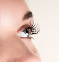 Beautiful young woman eyelash extension. Woman eye with long eyelashes. Beauty salon concept