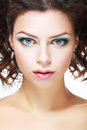 Beautiful young woman face of a with brightly blue eyes and perfect make up Stock Photography