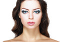 Beautiful young woman face of a with brightly blue eyes and perfect make up Stock Image