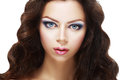Beautiful young woman face of a with brightly blue eyes and perfect make up Royalty Free Stock Images