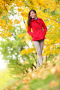 Beautiful young woman fall autumn nature scene with foliage slender stylish walking in colourful yellow Royalty Free Stock Image