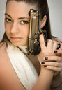 The beautiful young woman with fire-arms in hands Royalty Free Stock Images