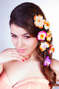 Beautiful young woman with flowers in hair fairy looking straight touching her chin by hand Stock Image