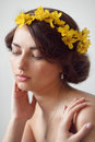 Beautiful young woman with flowers in her hair yellow Stock Photography