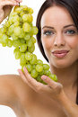 Beautiful young woman and fresh grapes portrait of green Stock Photos