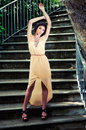 Beautiful young woman in a garden stairs. Royalty Free Stock Photo