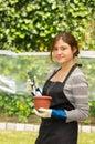 Beautiful young woman gardening holding a pot Royalty Free Stock Photos