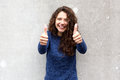 Beautiful young woman giving thumbs up Royalty Free Stock Photo