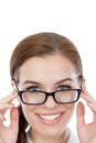 Beautiful young woman with glasses looking at the camera Stock Image