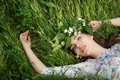 Beautiful young woman in green spring grass