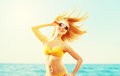 Beautiful young woman with hair flying in the wind and sunglasse Royalty Free Stock Photo
