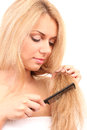 Beautiful young woman with hairbrush Royalty Free Stock Photography