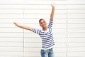 Beautiful young woman with happy expression and arms raised horizontal portrait of a Royalty Free Stock Images