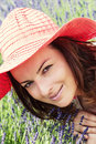 Beautiful young woman with hat in a lavender field caucasian red Royalty Free Stock Images