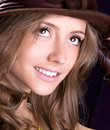 Beautiful young woman with hat is smiling Royalty Free Stock Photo