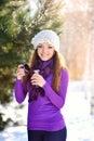 Beautiful young woman having a cup of tea in the winter sun sunÑŽ Stock Photo