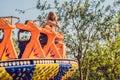 Beautiful, young woman having fun at an amusement park Royalty Free Stock Photo