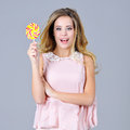 Beautiful young woman having fun with a candy Royalty Free Stock Photo