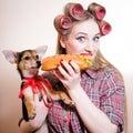 Beautiful young woman having fun eating hot-dog Royalty Free Stock Photo